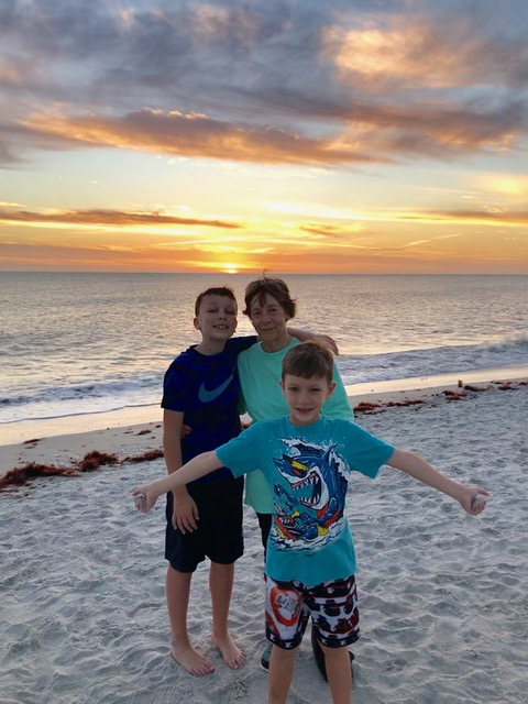 Kathy Berry and two grandsons enjoy a sunset on the Florida Beach.
